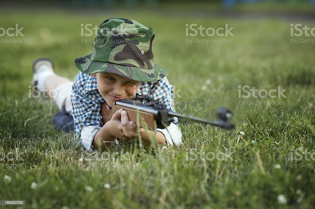 little boy with airgun royalty-free stock photo
