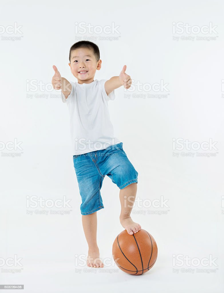 Little boy with basketball stock photo