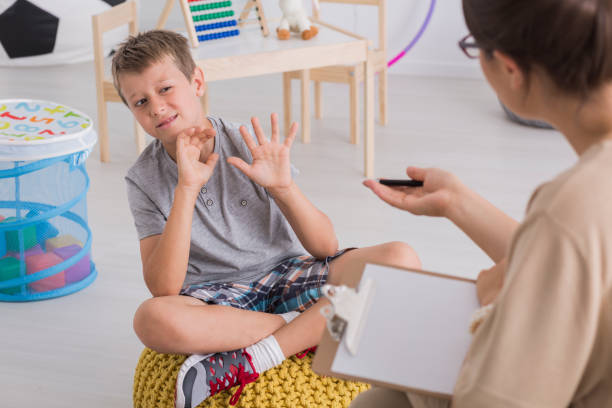 Little boy with behavioral problems stock photo