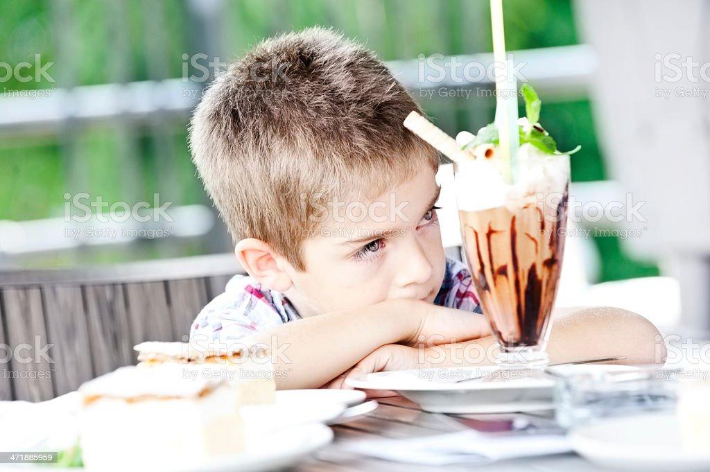Little boy with big ice cream sundae stock photo