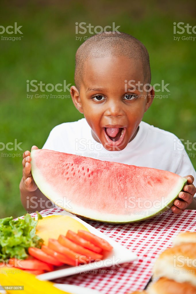Little boy with big slice of watermelon stock photo
