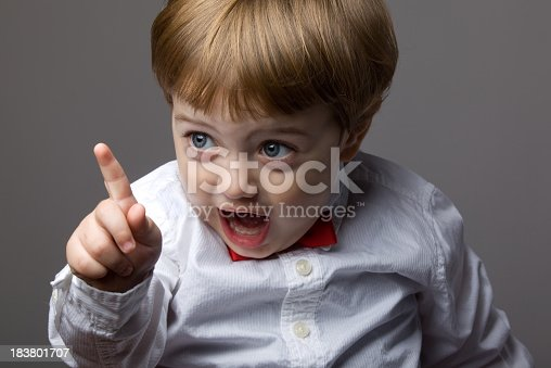 istock Little Boy With Blonde Hair Shaking His Finger For Warning 183801707