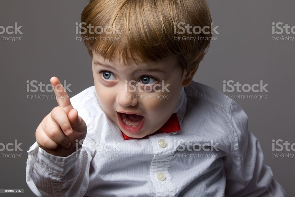 Little Boy With Blonde Hair Shaking His Finger For Warning stock photo