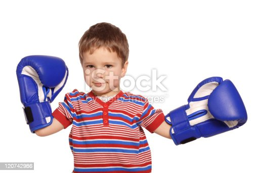 istock Little boy with boxing gloves 120742986