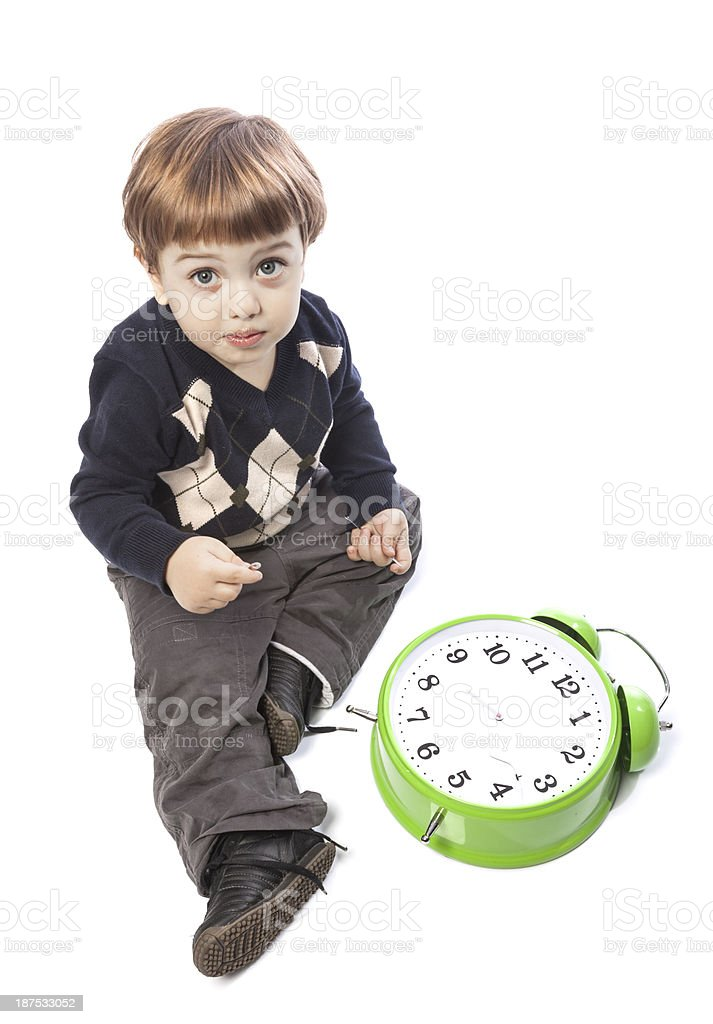 Little boy with broken clock on white background royalty-free stock photo