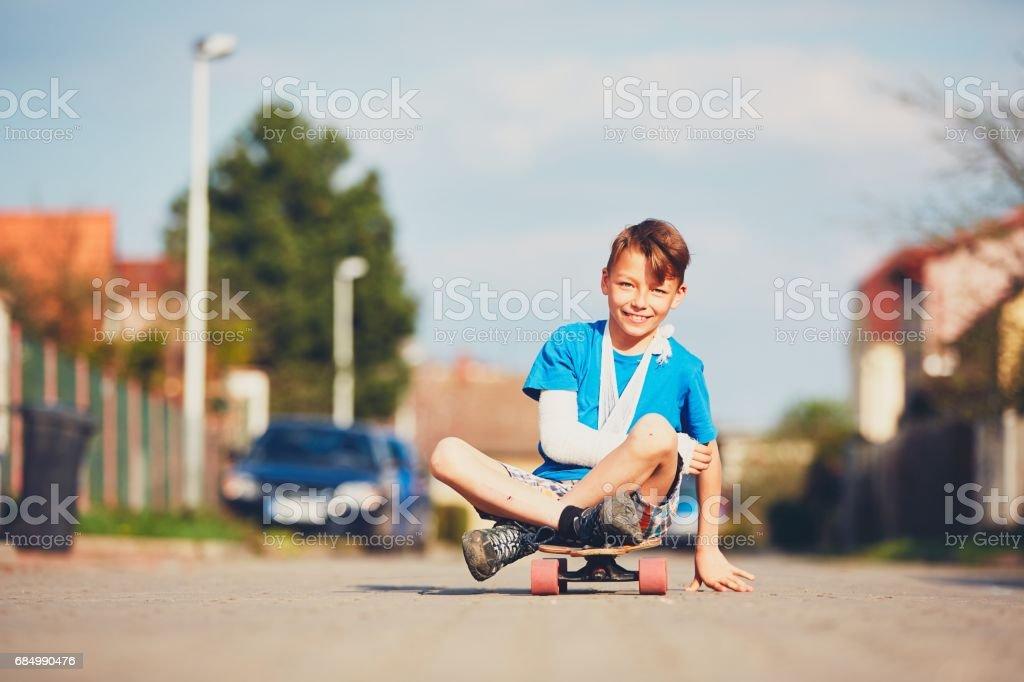 Little boy with broken hand stock photo