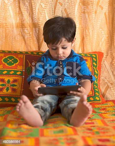 941782244 istock photo Little Boy with Digital Tablet 492586584