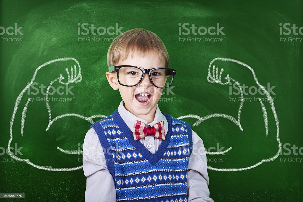 Little boy with drawn powerful hands stock photo