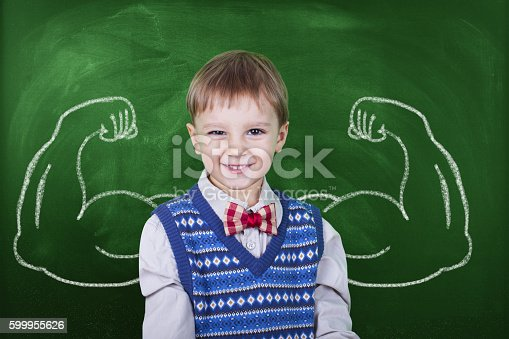 istock Little boy with drawn powerful hands 599955626
