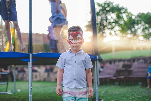 little boy with face paint on a birthday party - vorschulgeburtstag stock-fotos und bilder