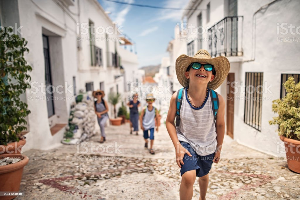 LIttle boy with family visiting andalusian white village stock photo