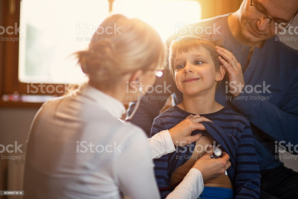 Little boy with father having medical examination stock photo