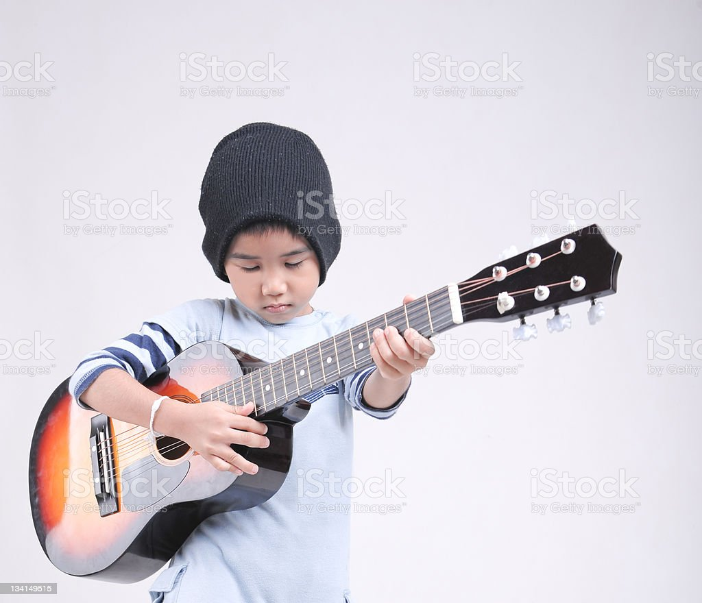 little boy with guitar royalty-free stock photo