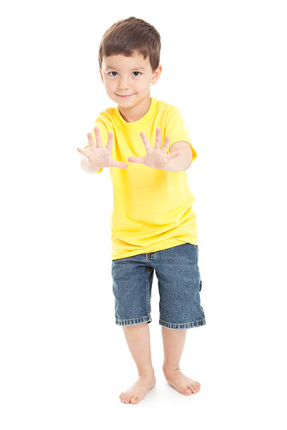 Little Boy With Hands Forward on White Background stock photo