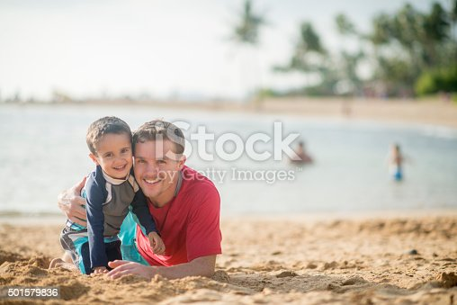 605742160 istock photo Little Boy with His Father at the Beach 501579836