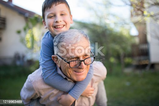 Little boy with his grandfather having fun outdoor