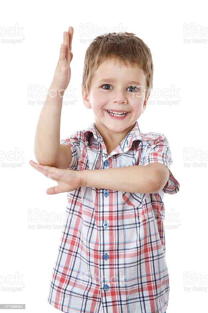 Little boy with his hand raised up stock photo