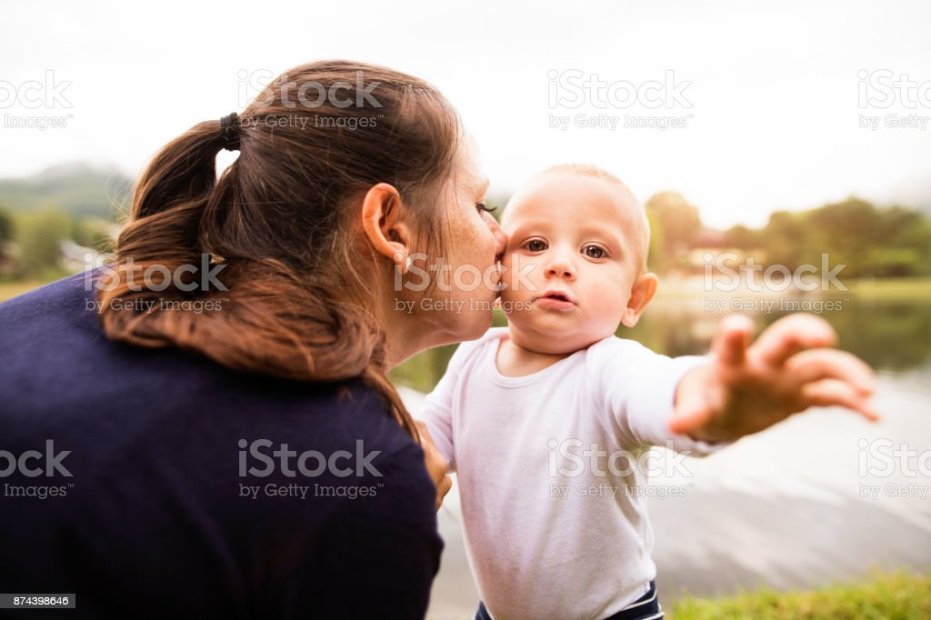 Little boy with his mother making first steps. royalty-free stock photo