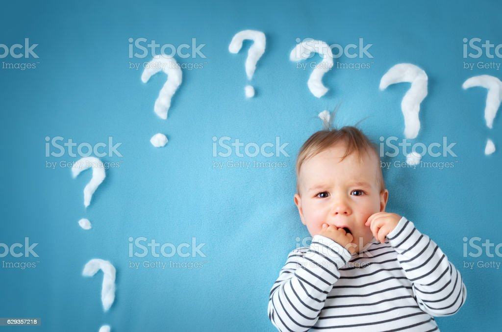 little boy with lots of question marks stock photo