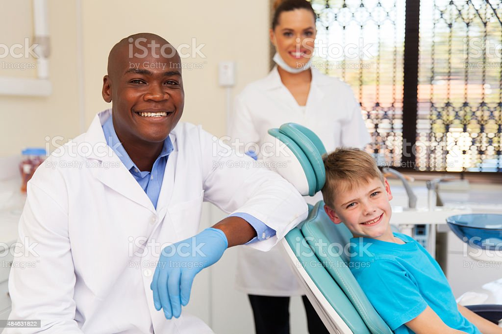 little boy with medical team dental clinic stock photo