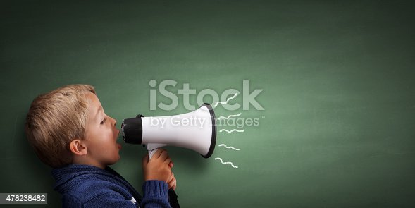 istock Little boy with megaphone 478238482