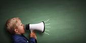 istock Little boy with megaphone 478238482