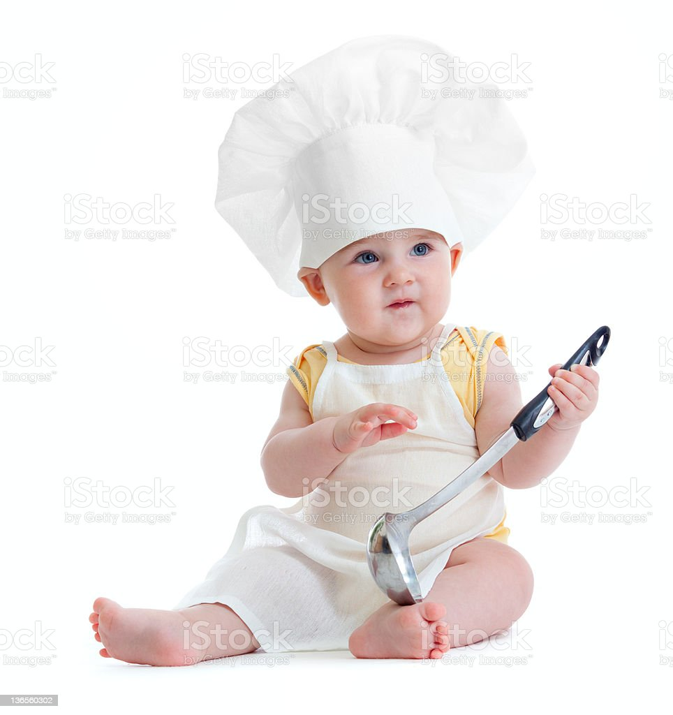 Little boy with metal ladle and cook hat isolated stock photo