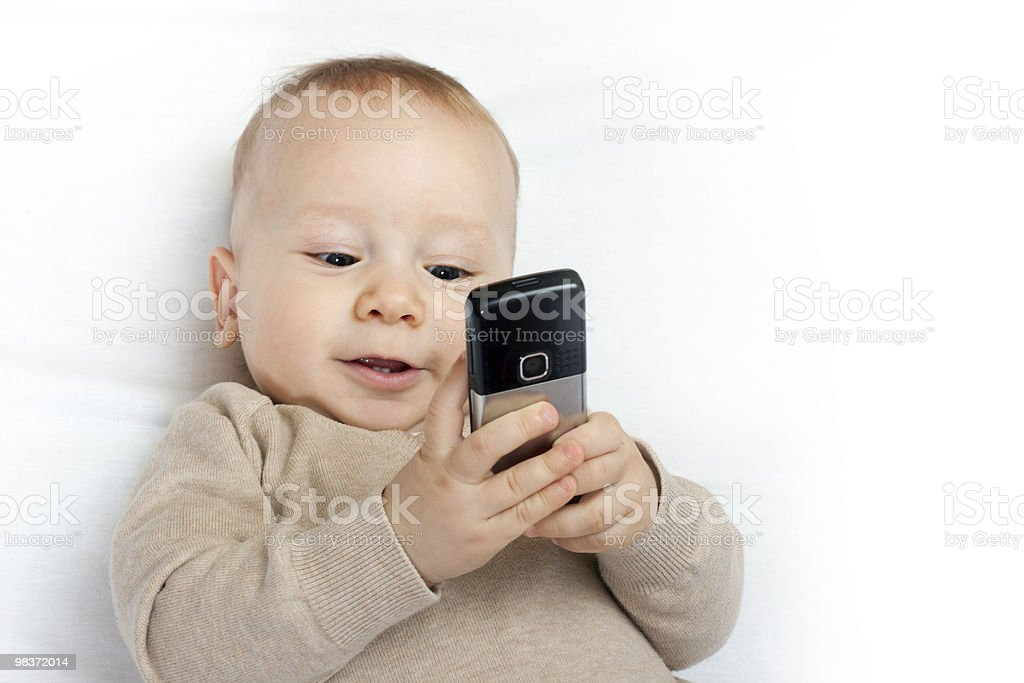 little boy with mobile phone royalty-free stock photo