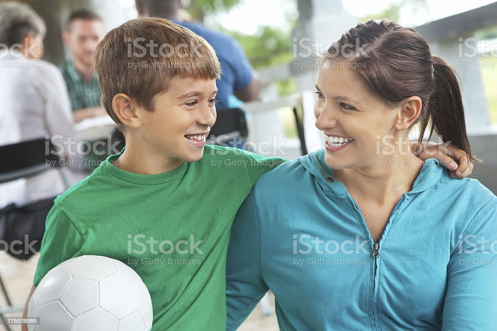 Little boy with mom signing up for league soccer stock photo