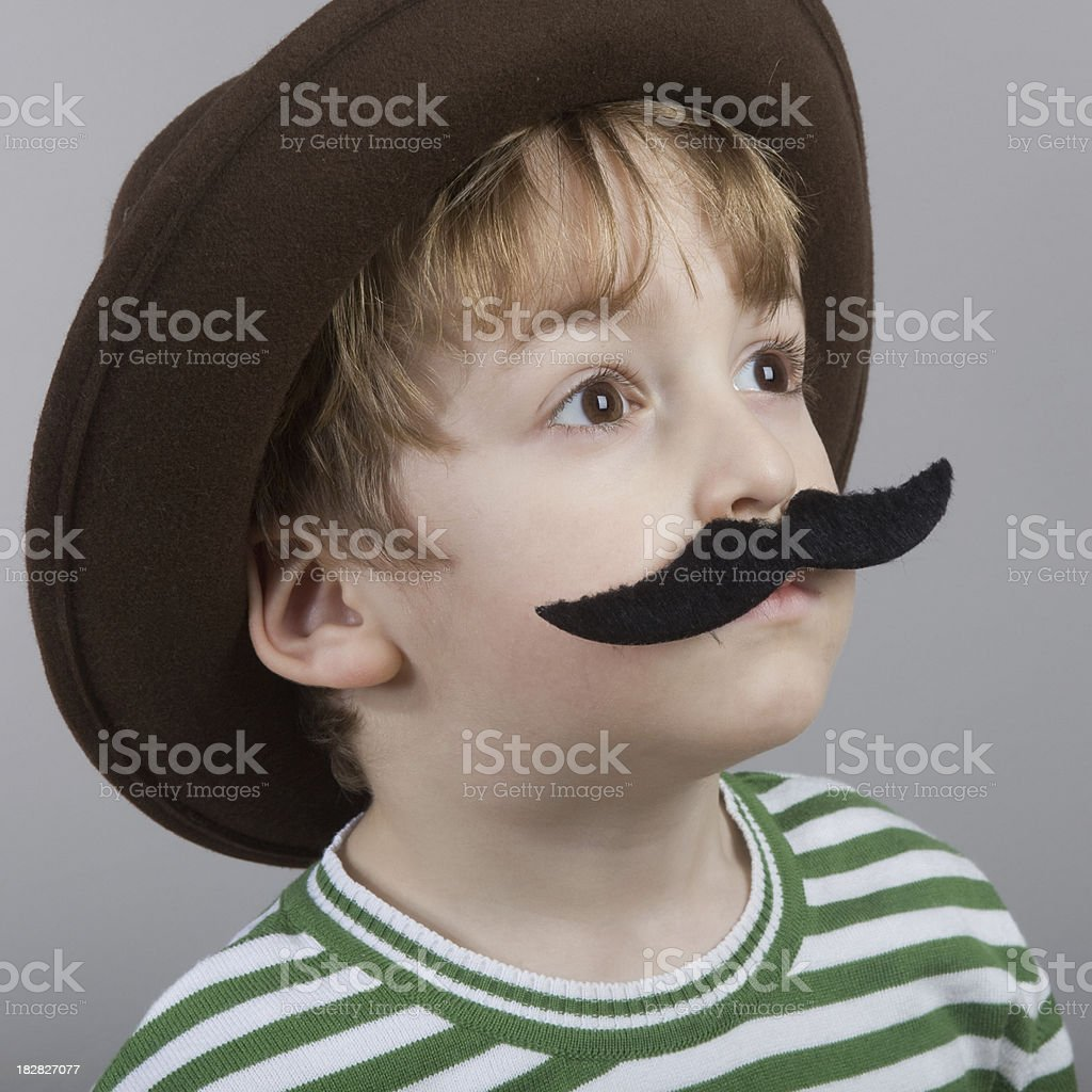 Little boy with mustache and hat royalty-free stock photo