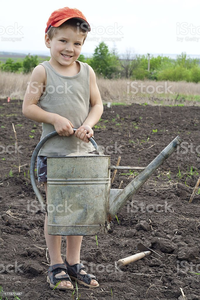 Little boy with old watering can royalty-free stock photo