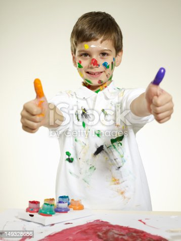 490853703 istock photo Little Boy With Painted Hands 149328686