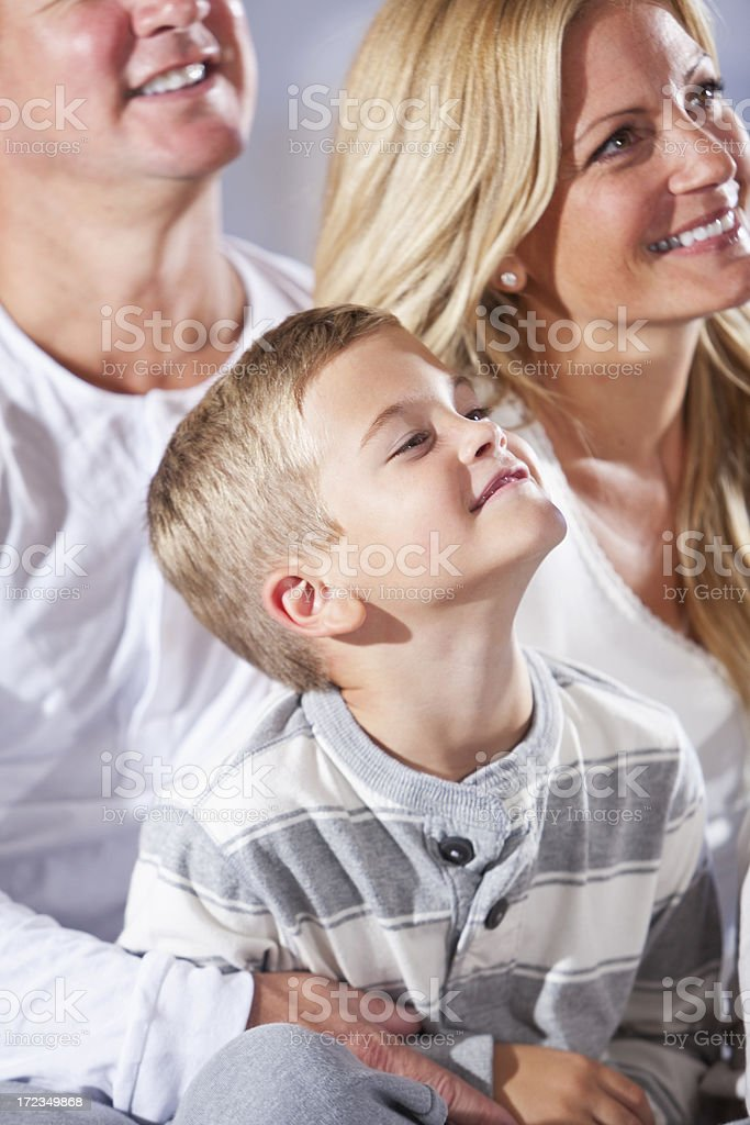 Little boy with parents stock photo