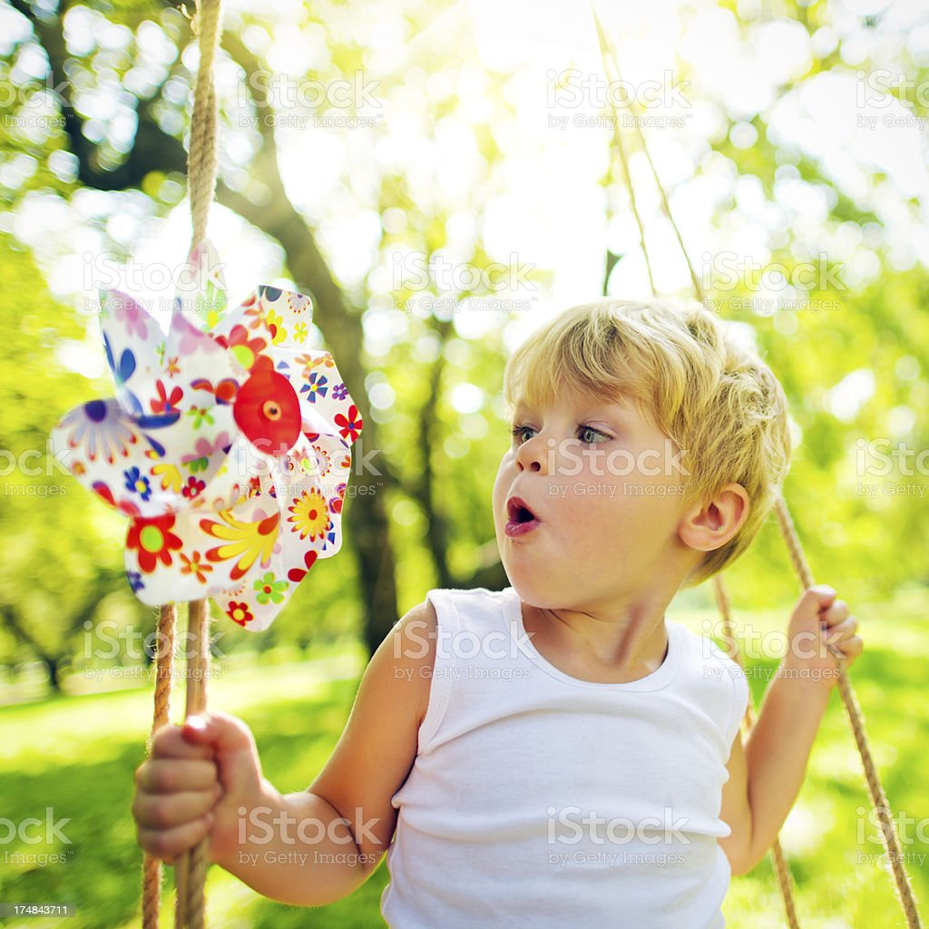 Little boy with pinwheel stock photo