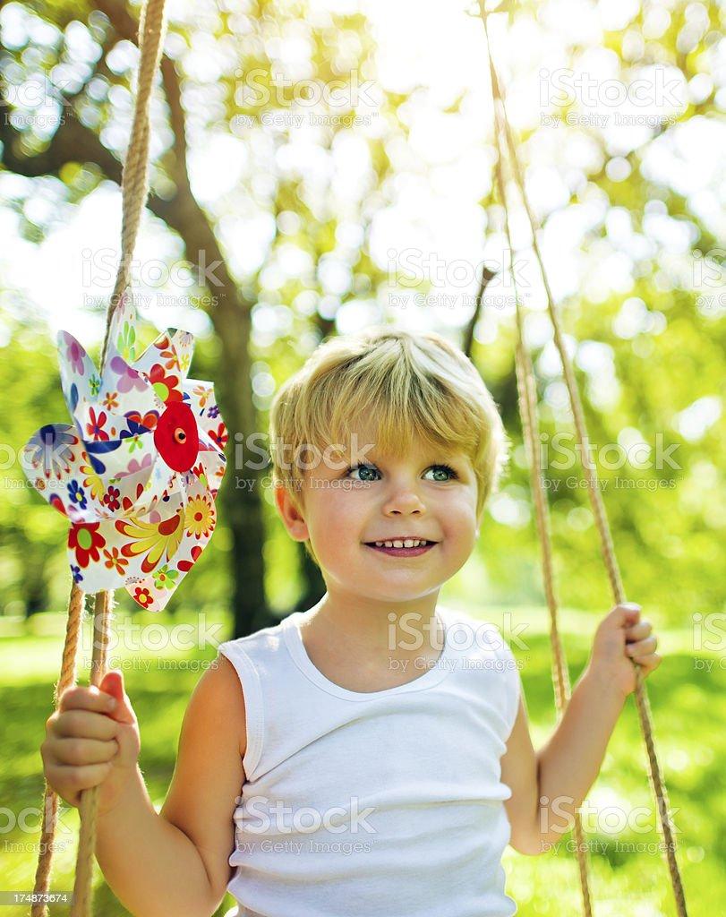 Little boy with pinwheel royalty-free stock photo