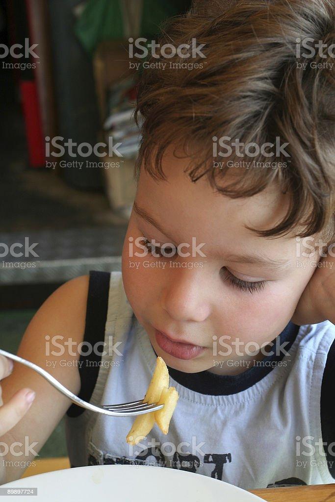 Little boy with potatos royalty-free stock photo