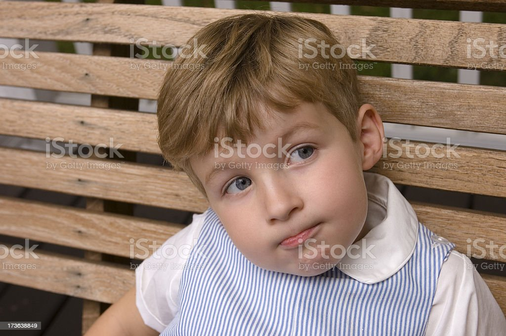 Little Boy with Quirky Grin stock photo