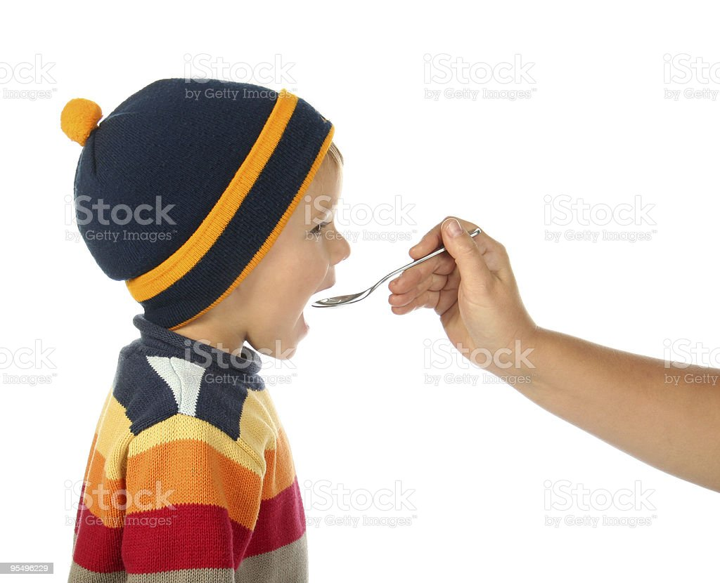 little boy with spoon in opened mouth royalty-free stock photo