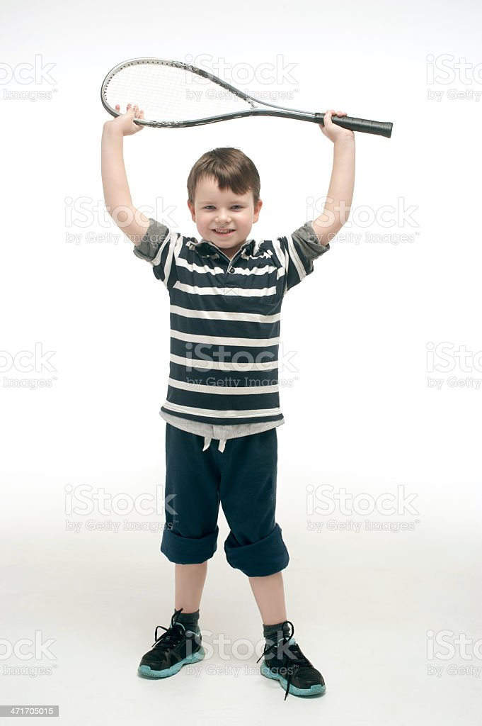 Little boy with tennis racket royalty-free stock photo