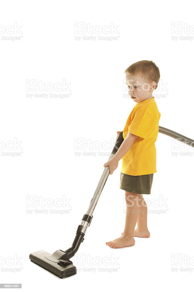 Little boy with vacuum-cleaner royalty-free stock photo