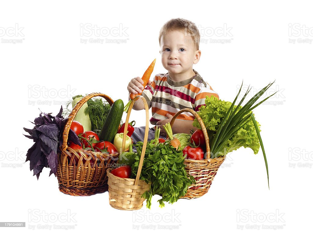 Little boy with vegetables royalty-free stock photo