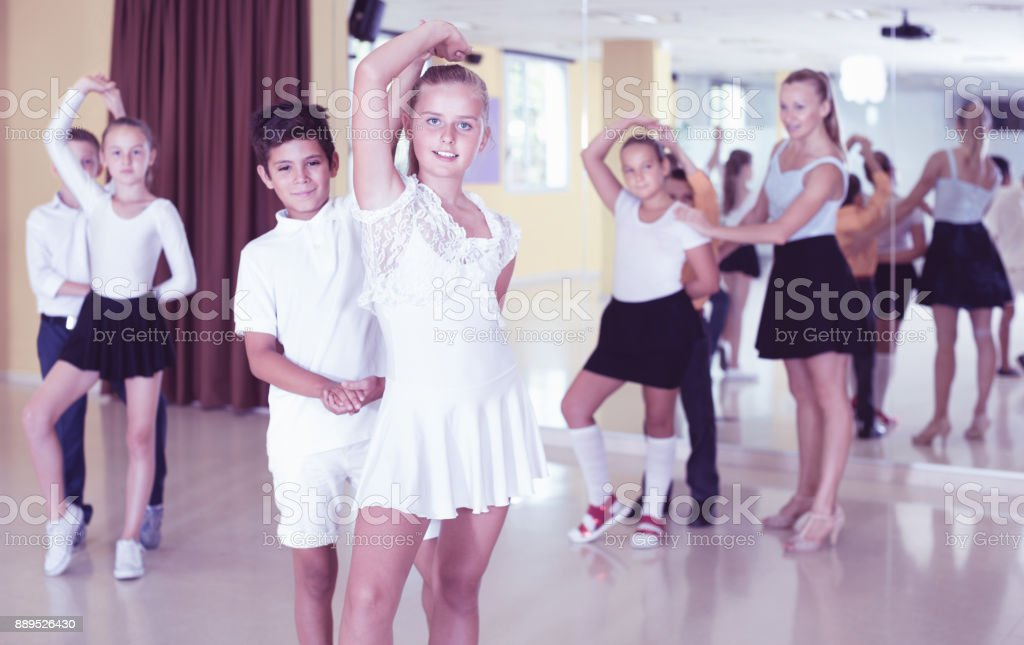 Little boys and girls having dancing class in classroom stock photo