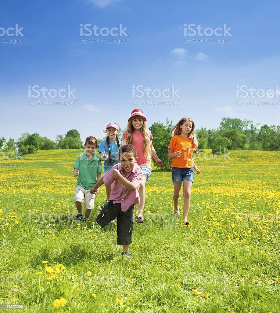 Little boys and girls running stock photo