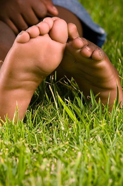 Little boy's feet stock photo