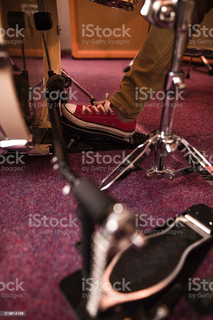 Little boy's foot on bass drum pedal. stock photo