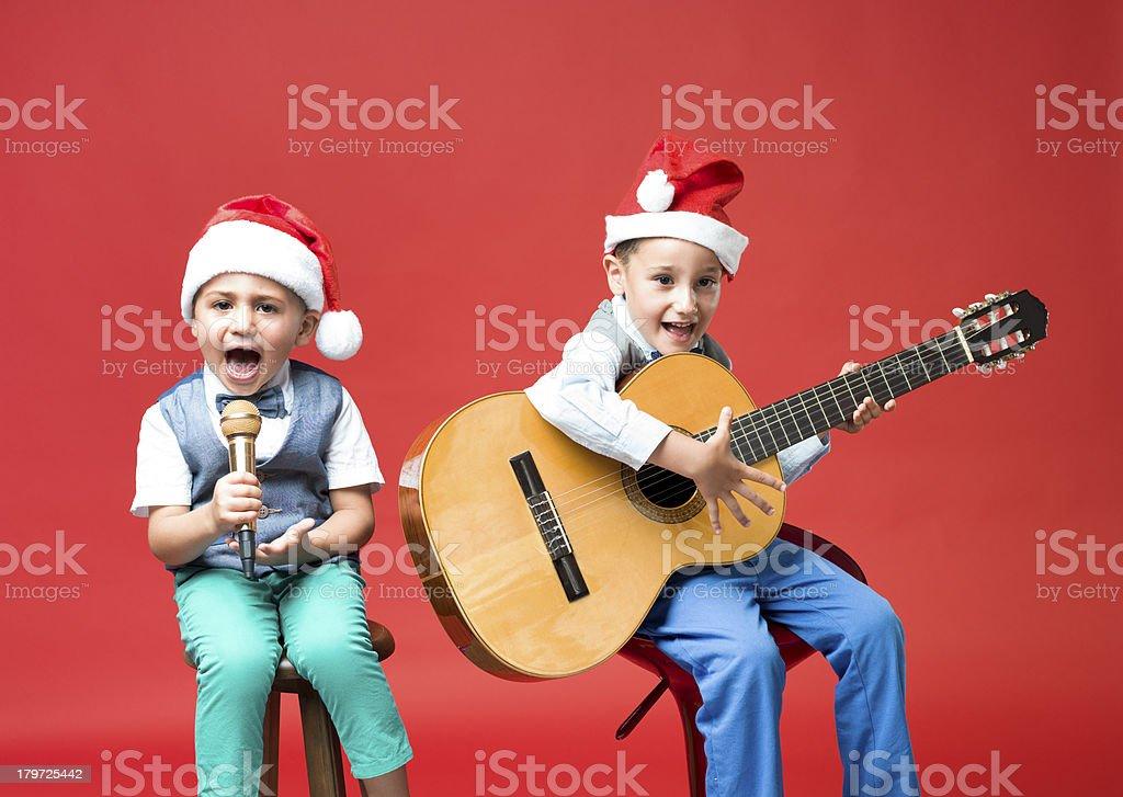 Little boys making music for Christmas stock photo