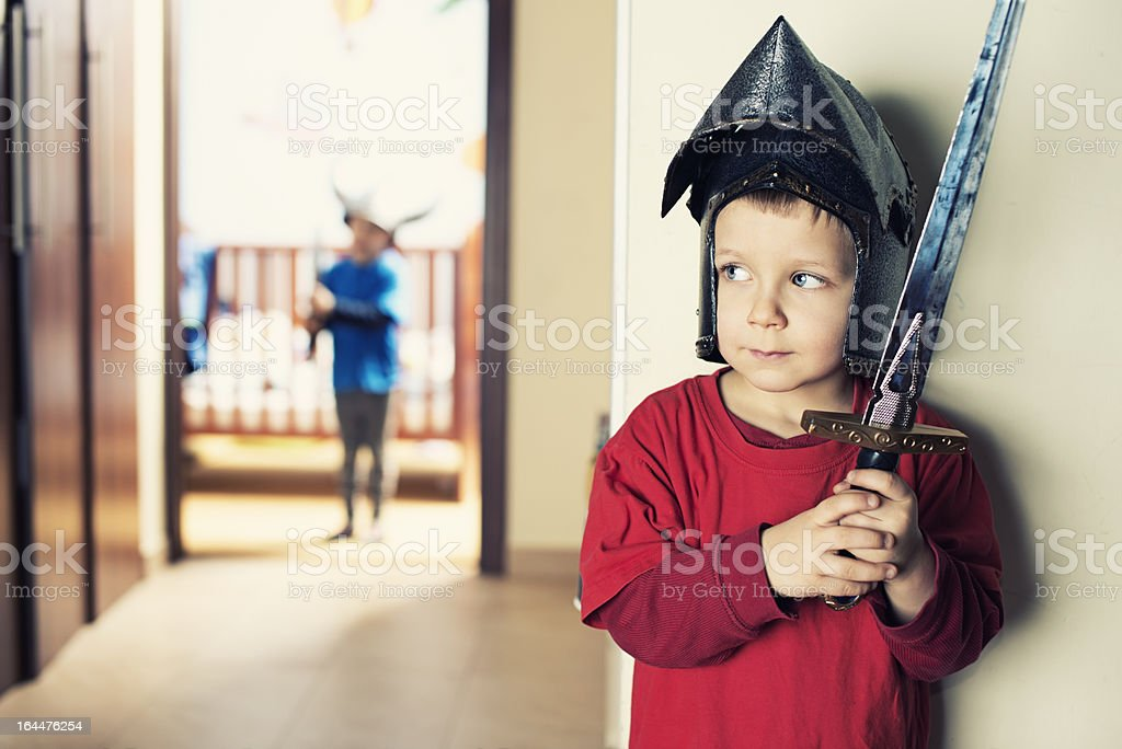 Little boys playing knights stock photo