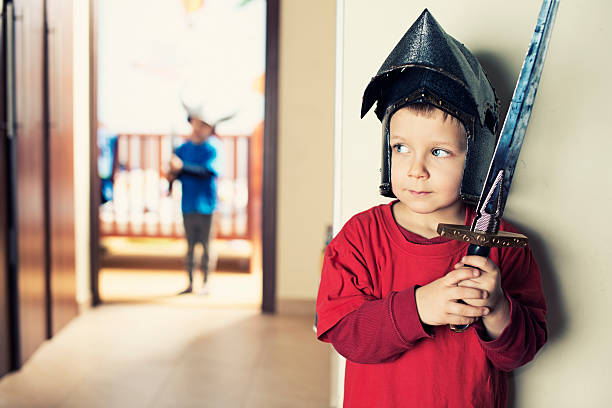 Little boys playing knights Brave little knight preparing to ambush the evil barbarian lord. ambush stock pictures, royalty-free photos & images
