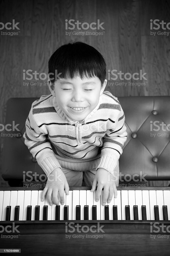 Little boys playing the piano royalty-free stock photo