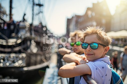 Brothers sightseeing Gdansk, Poland. They are walking in the city harbor and admiring the ships. Nikon D850